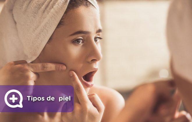 Mujer en el espejo tocando la piel del rostro, granitos, acné, piel atópica, seborreica, piel grasa, piel mixta, piel seca