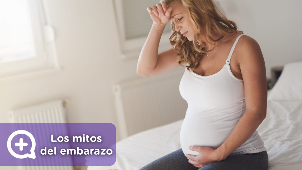 Mujer embarazada, con mareos, tomando medicación. remedios y mitos sobre el embarazo