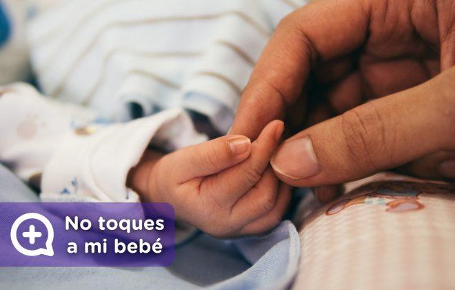 No toques a mi bebé. Vía de contacto, las manos, portadoras de virus y bacterias. MediQuo, tu amigo médico. Chat médico. Pediatría.